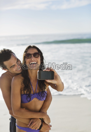 happy couple taking self portrait with