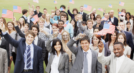 portrait of smiling business people waving