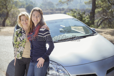 portrait of mother and daughter outside