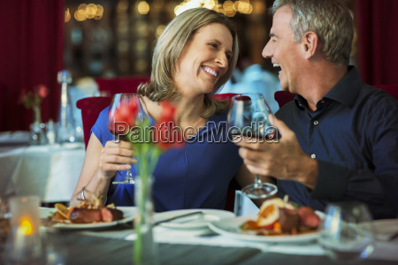 smiling happy mature couple looking at