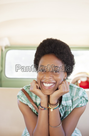 portrait of smiling woman in back