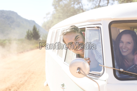 portrait of smiling couple in camper
