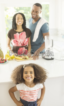 portrait of enthusiastic girl in kitchen