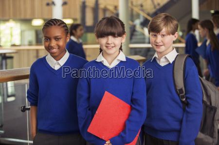 portrait of three elementary school children