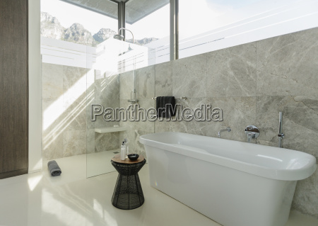 soaking tub in sunny modern bathroom