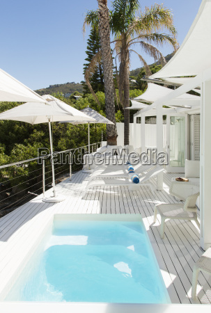 swimming pool and lounge chairs on