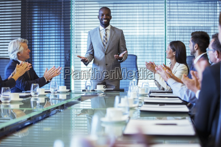 businessman giving speech in conference room