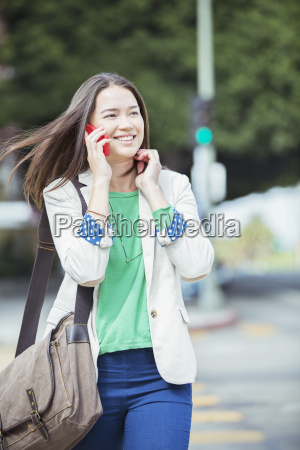 happy businesswoman talking on cell phone