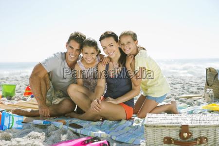 portrait of smiling family on blanket