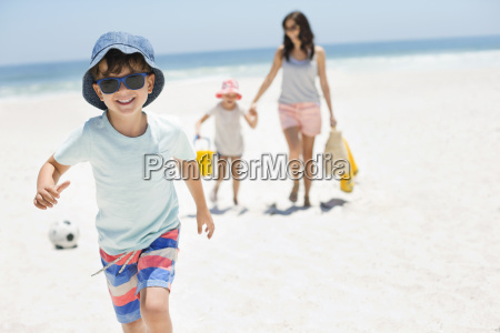 smiling boy running on beach