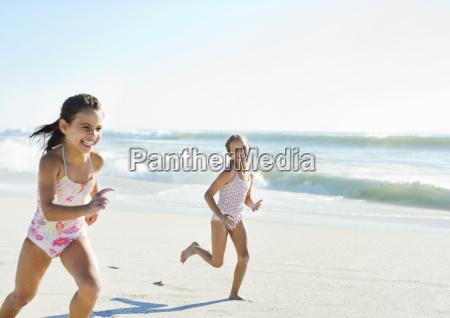 girls running on beach