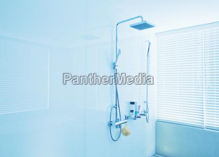 square shower head in modern bathroom