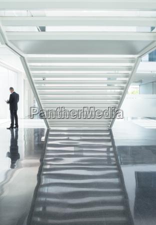 businessman in modern lobby