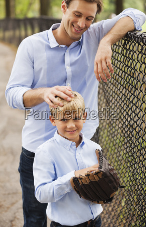 father and son in baseball field