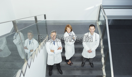 portrait of confident doctors on stairs