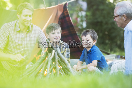 brothers camping with father and grandfather