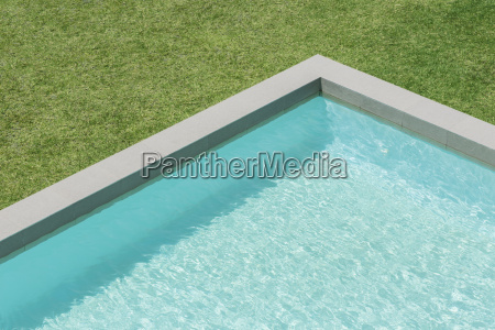 sunny view of swimming pool in