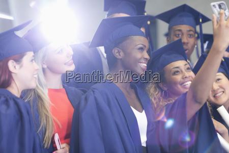 university students taking selfie in corridor