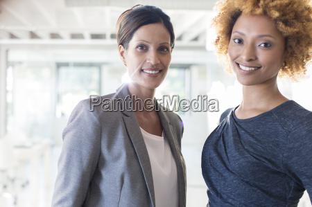 portrait of two smiling businesswomen in