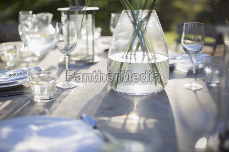 vase and place settings on sunny