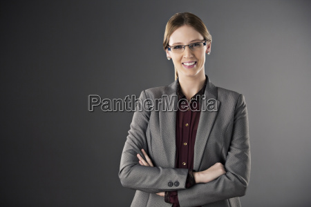 portrait of confident businesswoman with arms