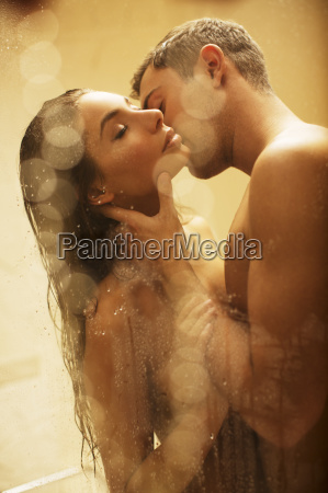 nude couple kissing in shower