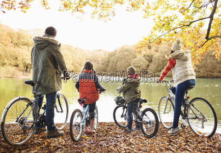 family sitting on bicycles together in