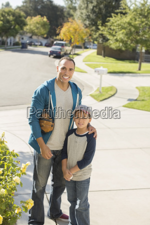 portrait of smiling father and son