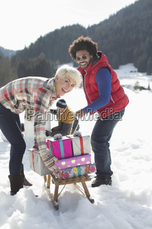 portrait of couple with sled and