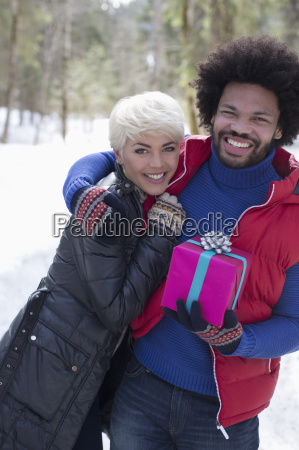 portrait of couple with christmas gift