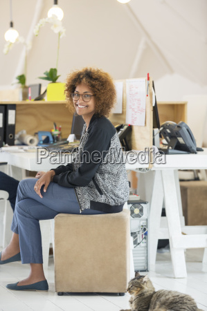 young smiling woman sitting at desk