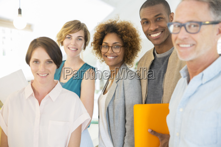 group portrait of smiling office workers