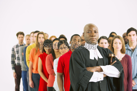 serious judge in front of crowd