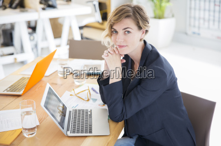 portrait of woman sitting at desk