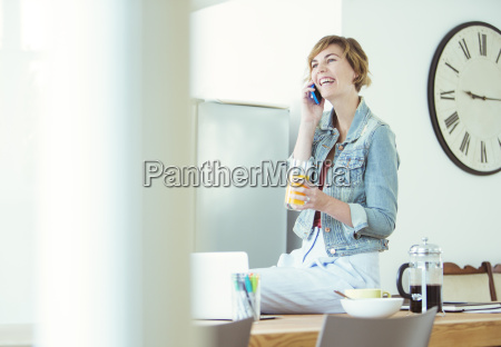 young office worker sitting on desk