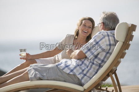 older couple relaxing in lawn chairs