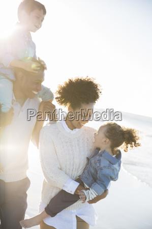 happy family having fun on beach