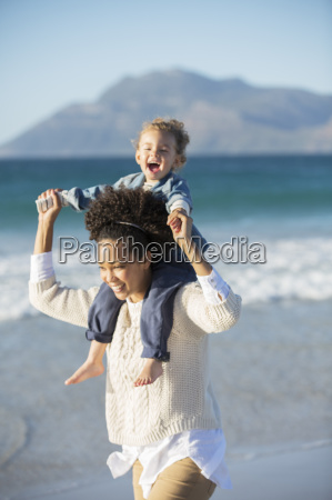 mother and daughter playing on beach