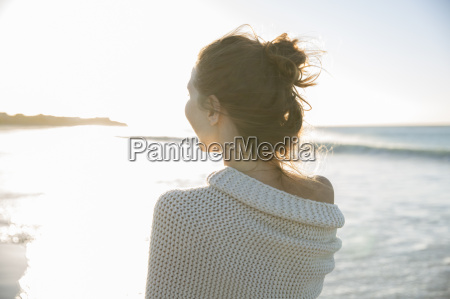 young woman wrapped in blanket on