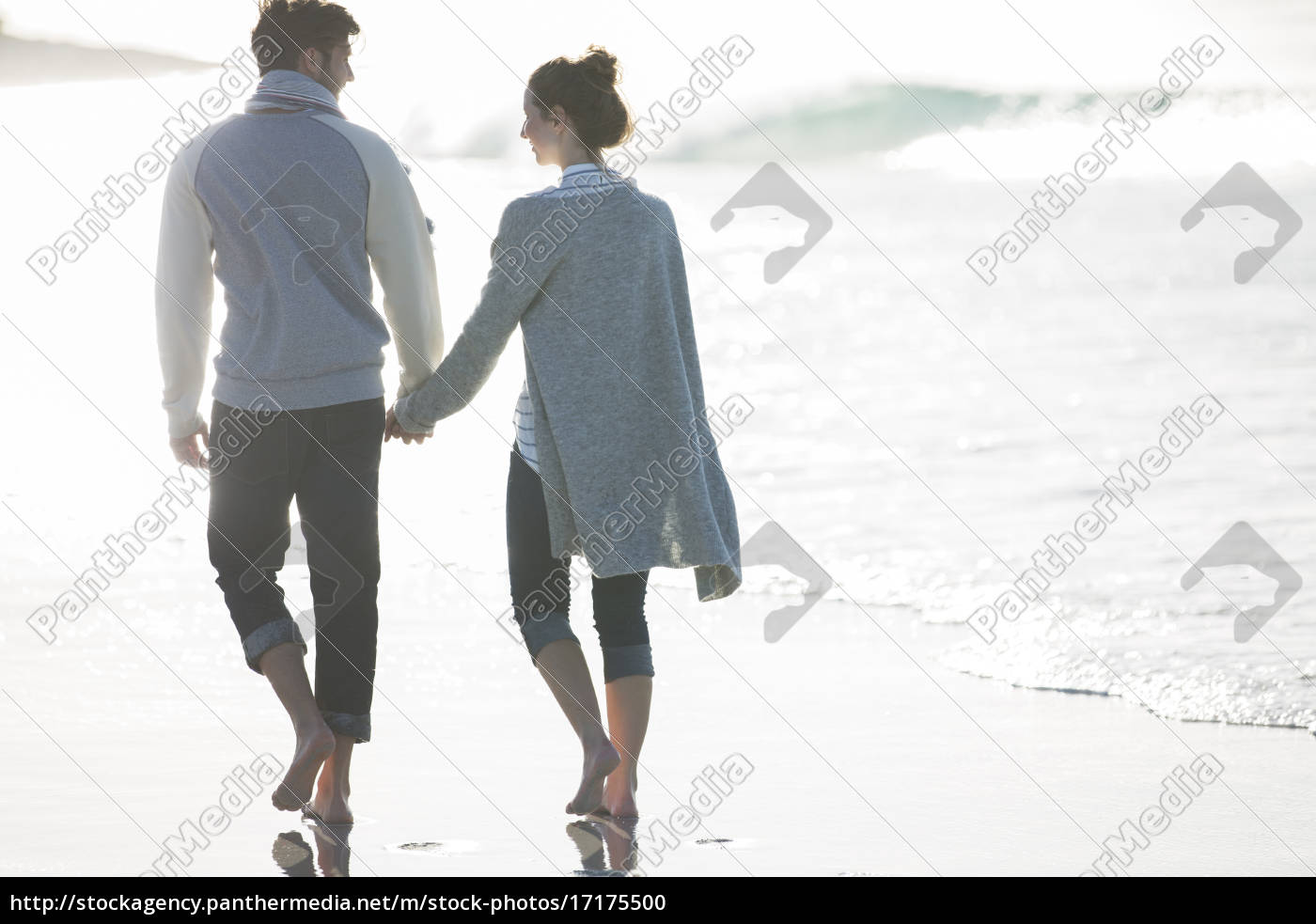 young, couple, holding, hands, and, walking - 17175500