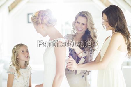 matron of honor and bridesmaid helping