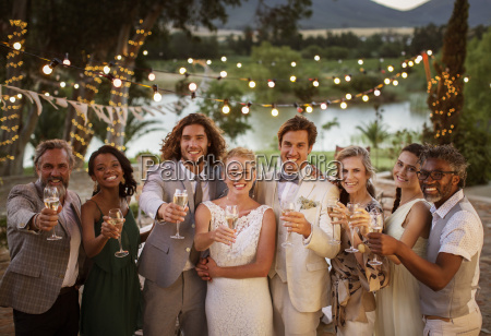 portrait of young couple with guests