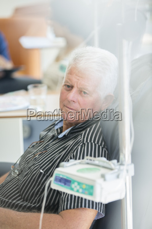 senior man receiving intravenous infusion in