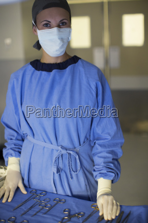 portrait of masked surgeon with set