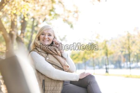 smiling senior woman talking on cell