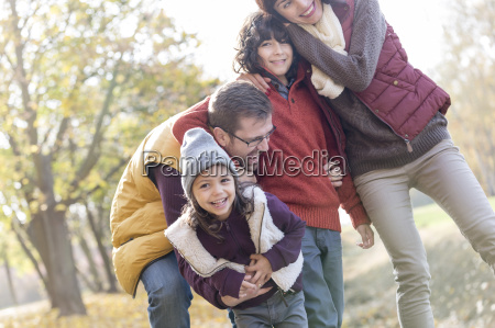portrait of playful family in park