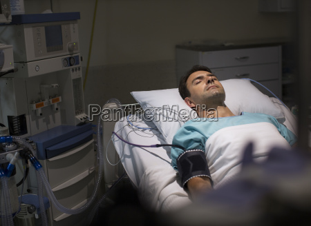male patient lying in hospital bed
