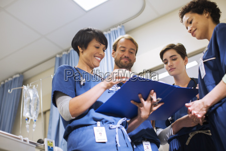 doctors wearing scrubs looking at documents