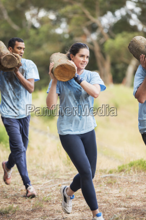 woman running with log on boot