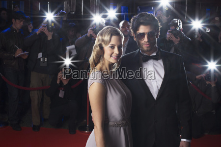 serious celebrity couple on red carpet